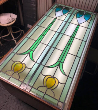 2 stained glass panels on a light table