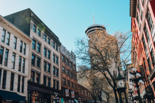 Streetscape of Gastown heritage buildings, looking towards steam clock and Harbour Centre tower